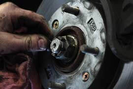 Midas mechanic performing a brake repair service